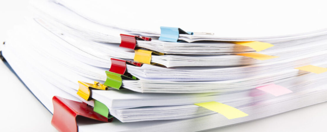 Pile of documents with colorful clips